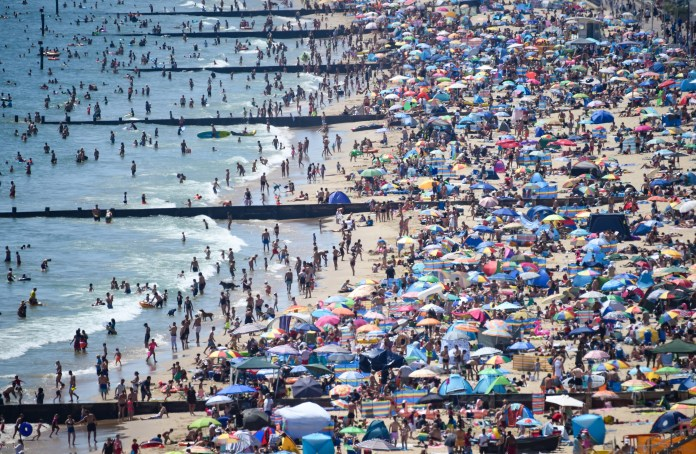 Tens of thousands of Britons flocked to Bournemouth Beach yesterday