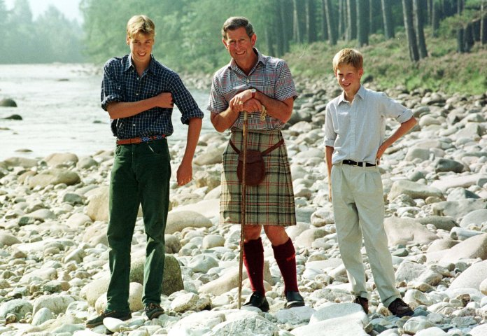 The brothers pose with their father Prince Charles, both happier