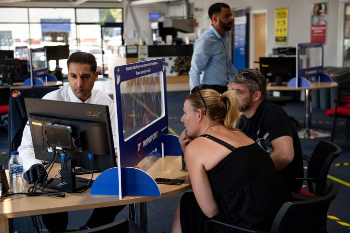 Photos show staff and customers separated by screens