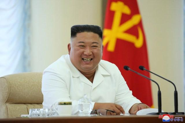 Kim seen smiling at the June 7 meeting
