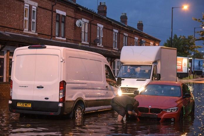 Cars go through flash floods in Stourbridge, England