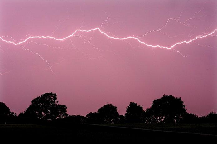 Lightning pictured across fields along Aldridge Road in Walsall