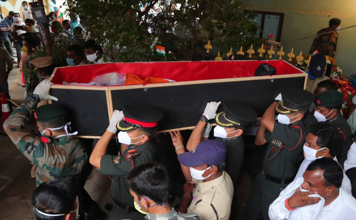 Indian army officers carry the coffin of Colonel Bikumalla Santosh Babu