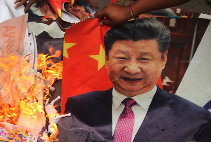 Photos of Chinese President Xi Jinping burned during protests