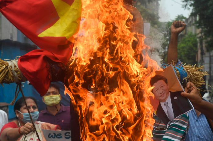 Indian protesters burn Chinese flag as rage rises
