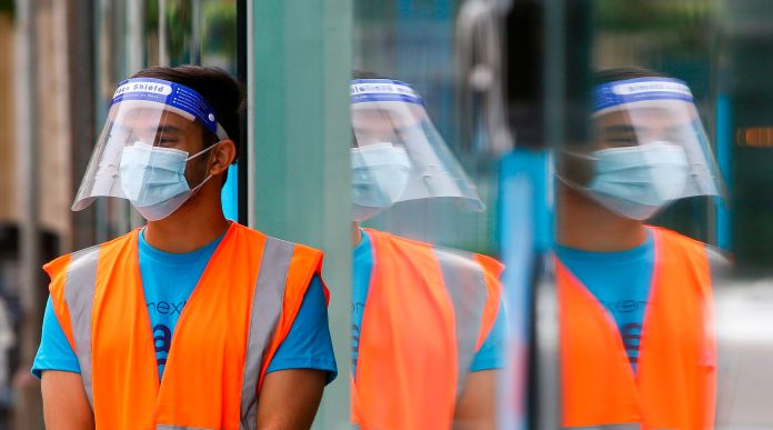 A worker in the retail trade as the wearing of PPE is held in Cardiff