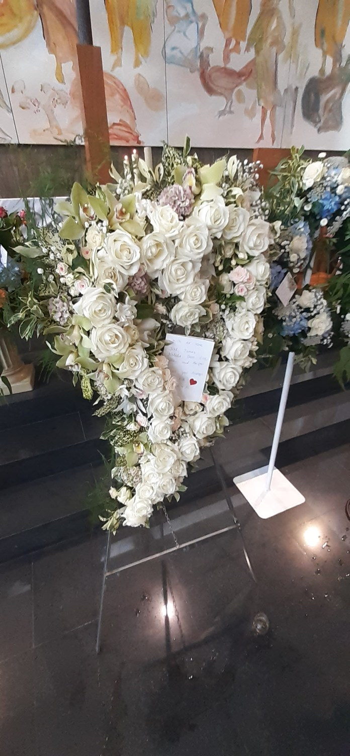 Tributes floral to the star have been presented to the church
