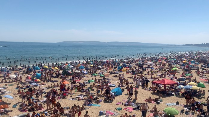 Bournemouth said major incident Wednesday after emergency services struggled to cope with herd of sun seekers