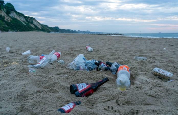 Empty beer bottles were left in the sand
