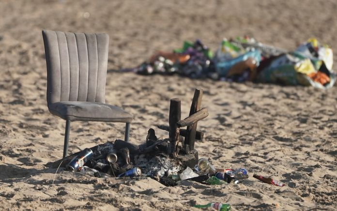 An old chair and barbecue have been thrown away on Tynemouth Beach in the North East of England