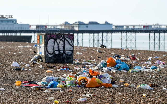 Heaps of trash flooded Brighton Beach this morning after yesterday's crowd