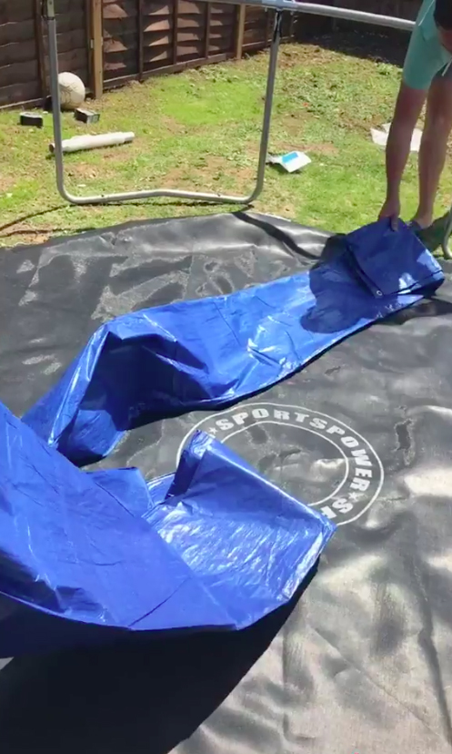 A huge, durable tarpaulin holds the water together, while black shrink wrap keeps it warm