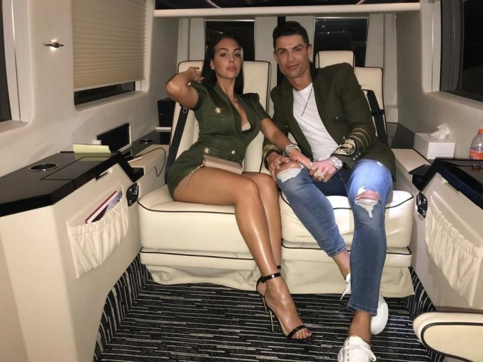 Ronaldo, pictured with partner Georgina Rodriguez, has beaten Messi to the $1bn mark