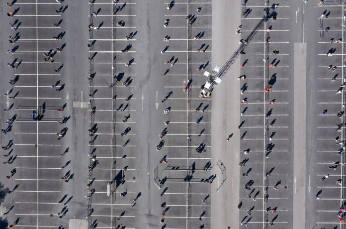 Aerial photos show customers waiting to enter Warrington