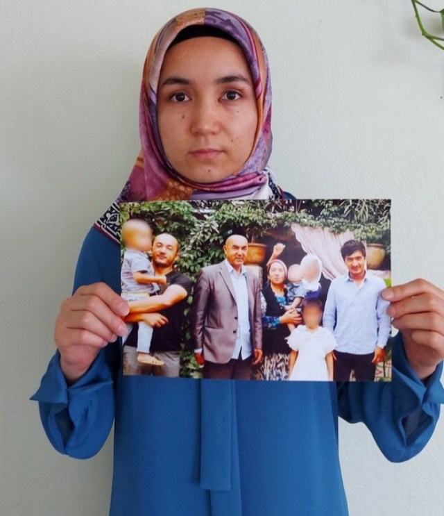 Marketing executive Nursimangul Abdurashidholds a picture of her Uighur family members, who have been detained by China