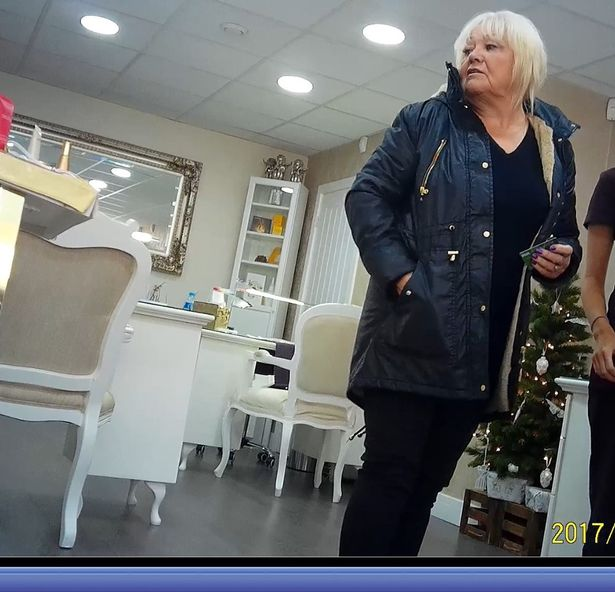The scamming gran is pictured out of her wheel chair in the same year