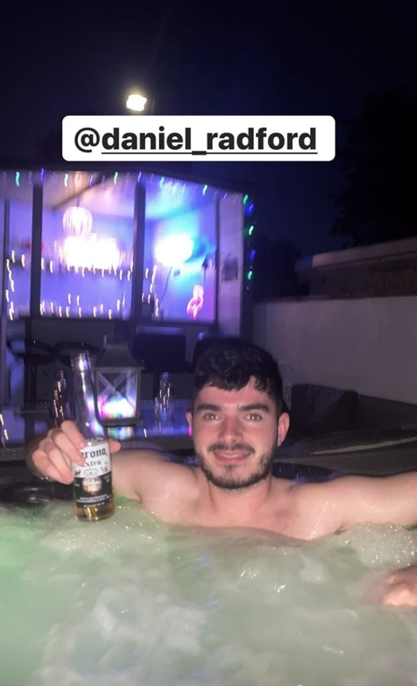 Son Daniel sipped on a Corona beer in the tub