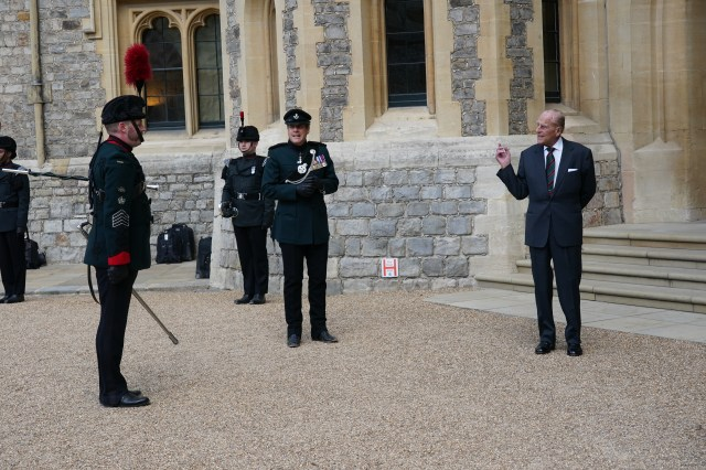 The royal spoke to officers socially distanced due to coronavirus