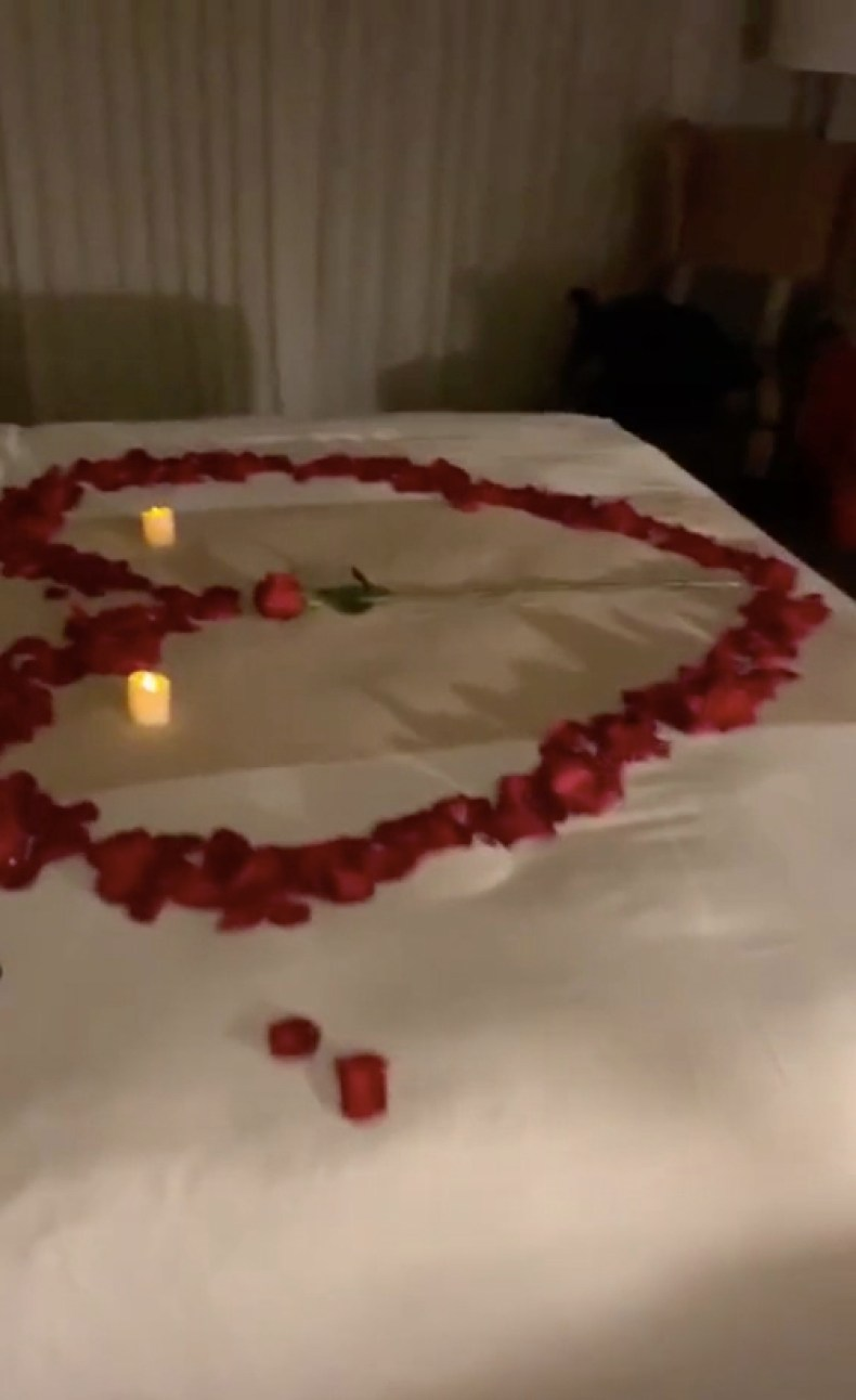 The TikTok star also showed inside her petal-covered hotel room