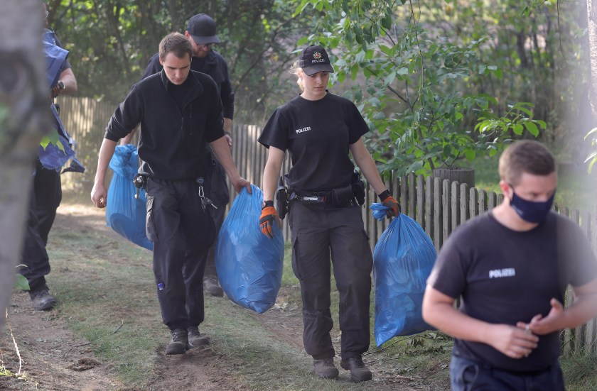 Officers were pictured carrying bags away from the site as part of the probe