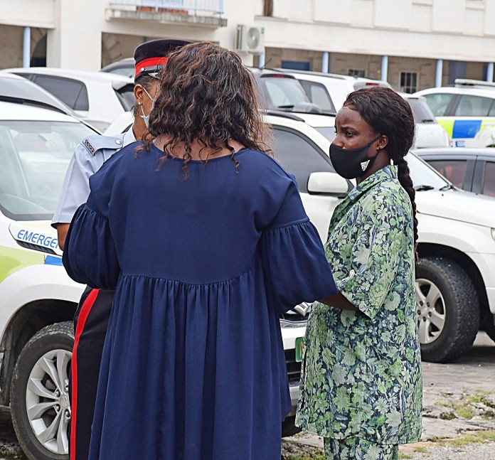 The 33-year-old speaks with her lawyer and an officer before heading to court