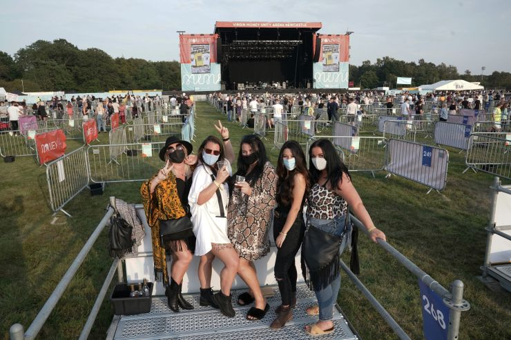 Fans wore face masks as they walked around the site