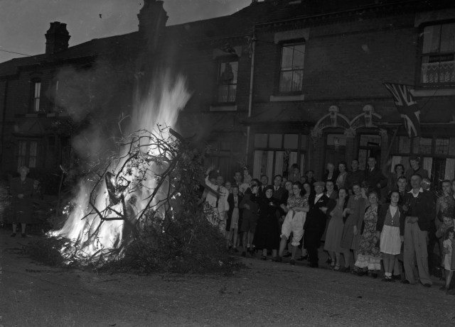 Children, mums and dads celebrate VJ Day by burning bonfires on the streets of Birmingham August 15, 1945