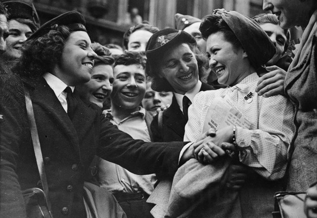 British WRENS congratulate Mrs Lotus Lee-Chang whose husband was an Army lieutenant, fighting somewhere in China, on VJ Day