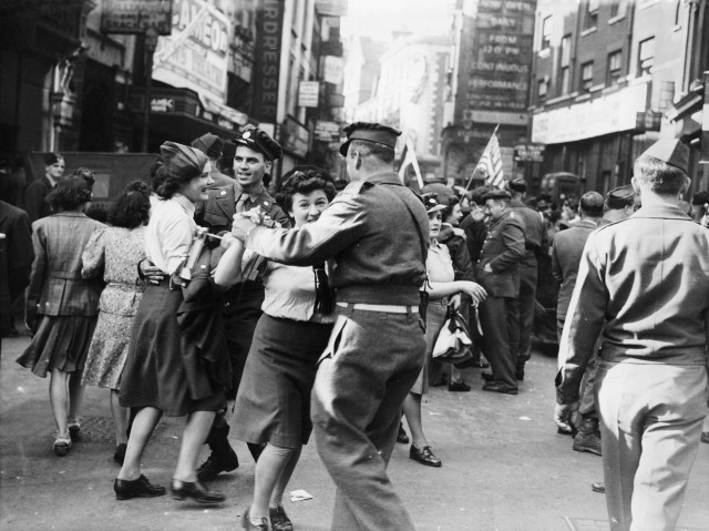 Dancing in the streets of London on VJ Day after Japan surrendered to the Allies