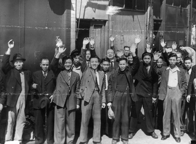 Members of the Liverpool Chinese community cheering on hearing good news of the Japanese offer to accept unconditional surrender, August 1945