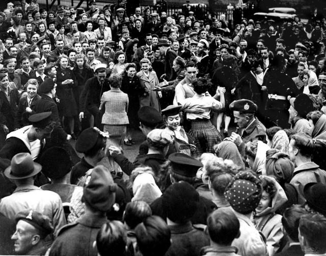 Edinburgh, in Scotland marks VJ Day August 1945 - celebrating people dance in the streets