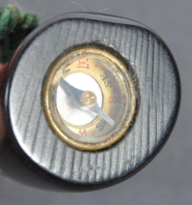 A duffel coat toggle hides a miniature escape compass