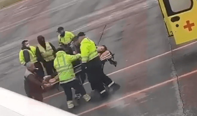 Footage showed the activist being stretchered from the aircraft