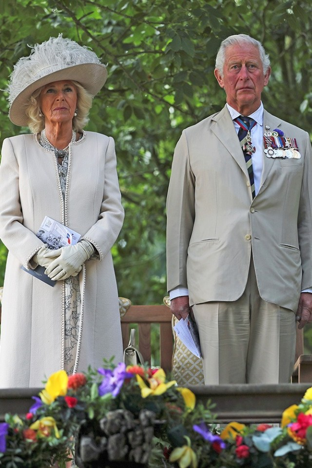 Prince Charles and Camilla, Duchess of Cornwall, observe a minute's silence