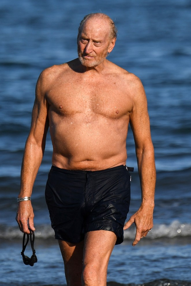The legendary British actor, 73, showed off his toned frame as he took a dip in black swimshorts