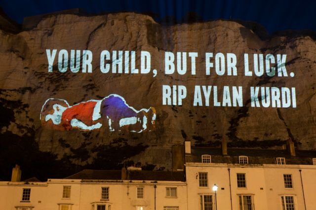 Pro-migrant groups projected words of sympathy for migrants crossing the channel onto the Cliffs of Dover on Friday night