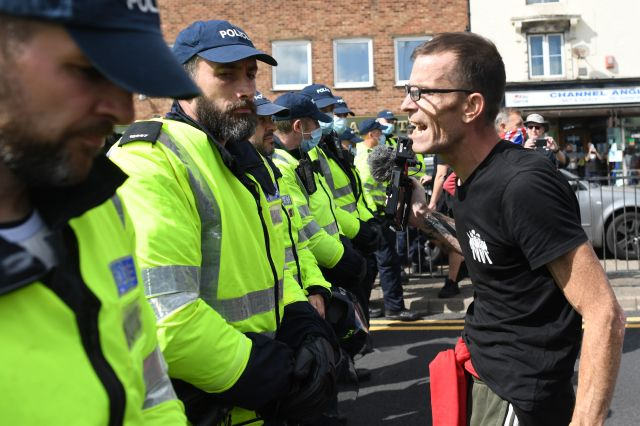 A man faced up to officers who turned up to the demonstration
