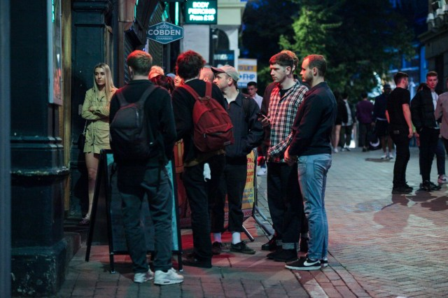 Groups of drinkers hit the town in Nottingham for one last night out before new lockdown measures