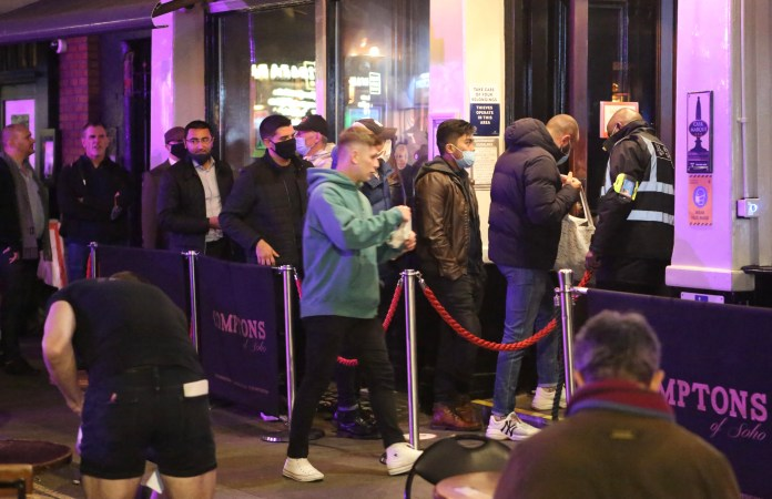 Crowds line up in London to enter bars