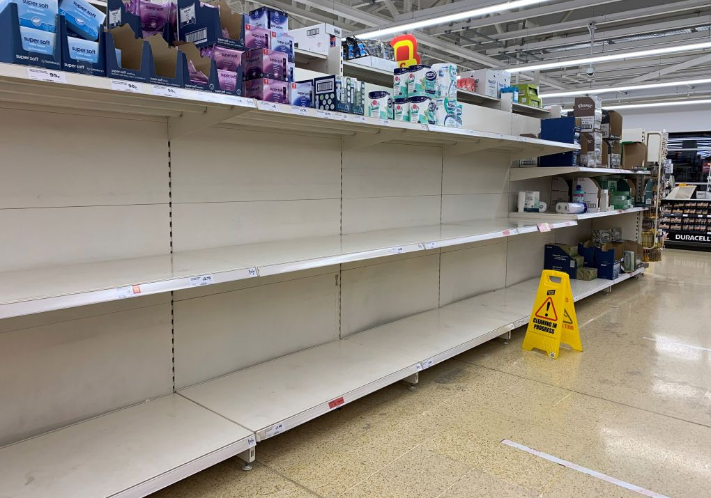 Empty shelves where toilet rolls are usually stocked at a Sainsbury's in Wandsworth