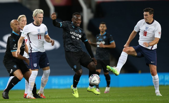 Michael Essien guards the ball from Gareth Barry and Olly Murs