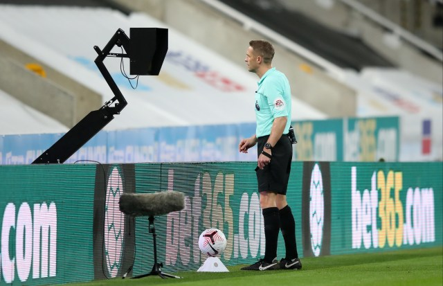 Ref Craig Pawson consults the VAR monitor before awarding a penalty