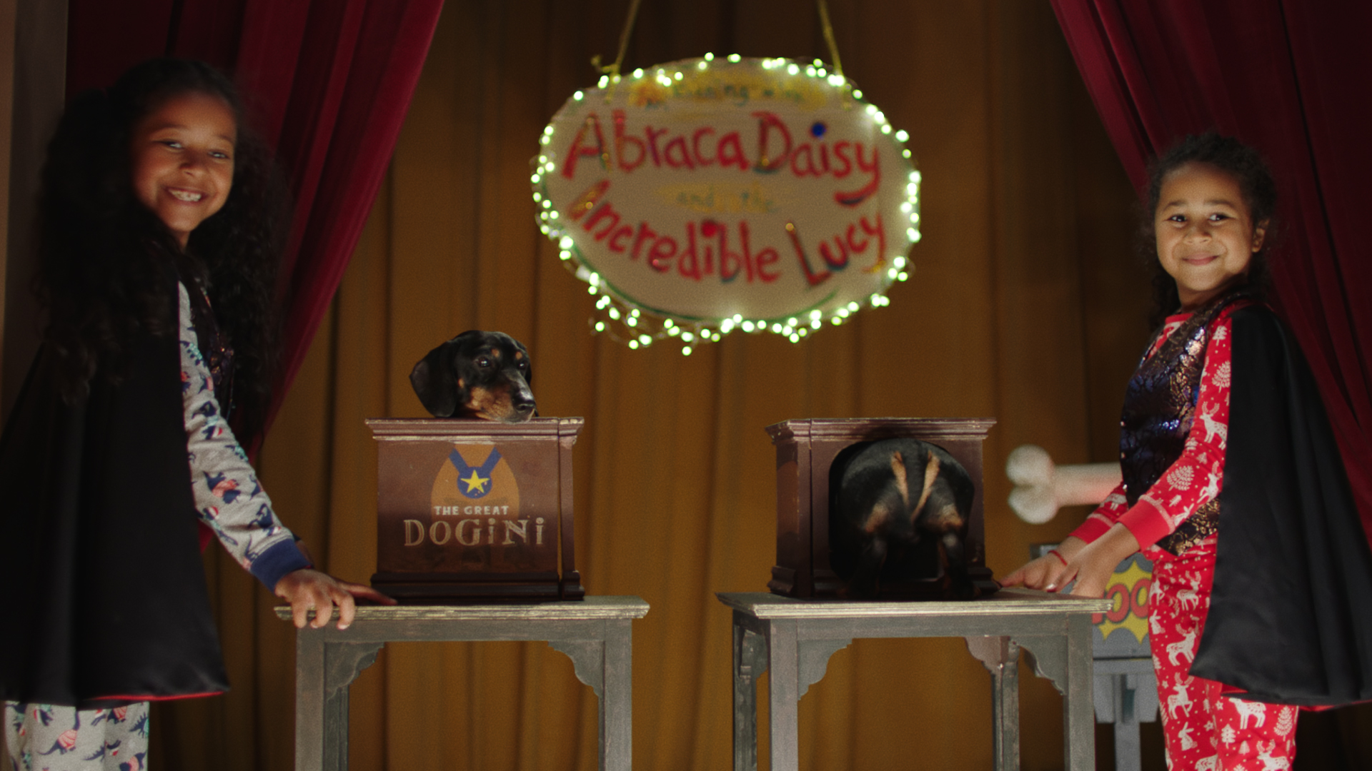 Argos' Christmas ad for 2020 features two sisters, Lucy and Daisy, putting on a magical performance in front of their family