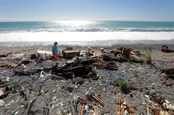 Residents inspect the wreckage on a private beach in Nice