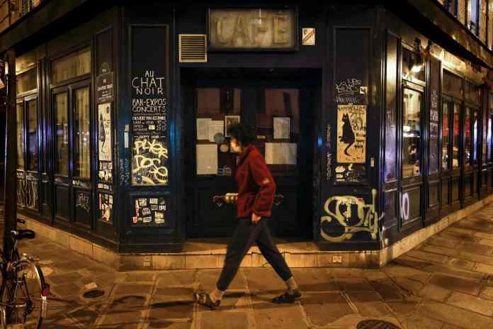 A Parisian walks past the famous Au Chat Noir bar