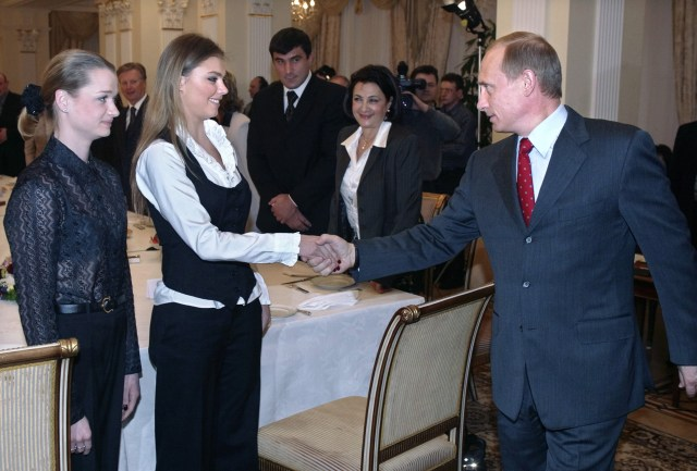 Vladmir Putin shakes hands with Alina while meeting the Russian Olympic team in 2004