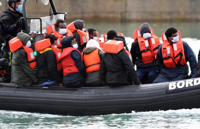 Migrants are being smuggled halfway across the Channel in fishing boats before being dumped in dinghies