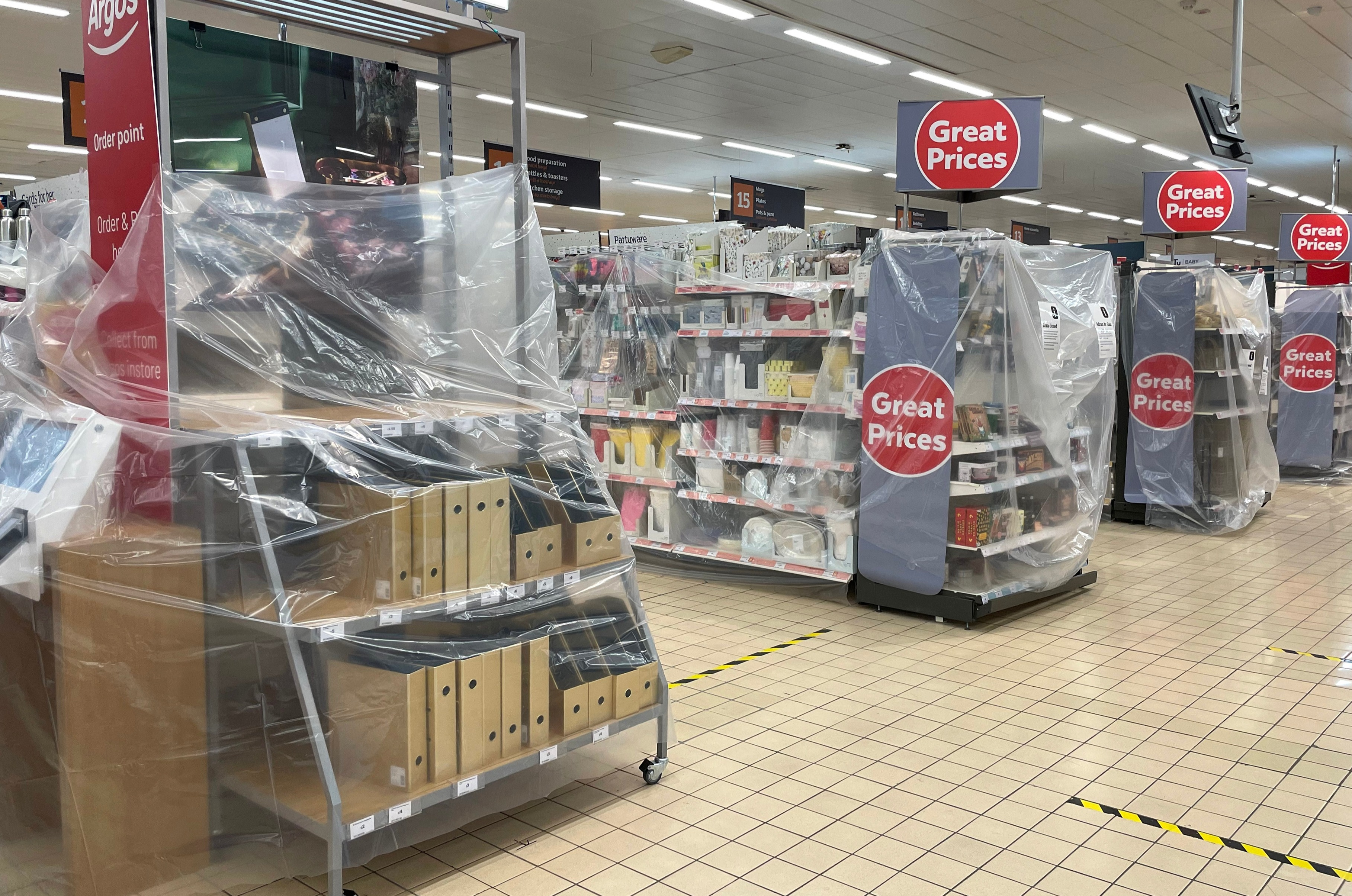 Some aisles in Welsh supermarkets have been blocked off