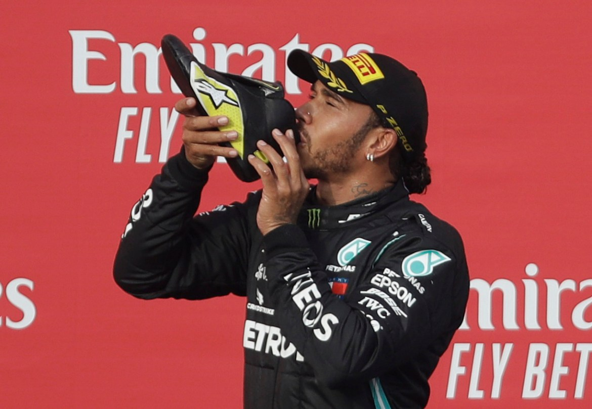 The championship leader indulged in a shoey after Daniel Ricciardo secured the final podium position