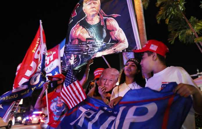 Trump supporters cheer for him outside Versailles restaurant in Miami